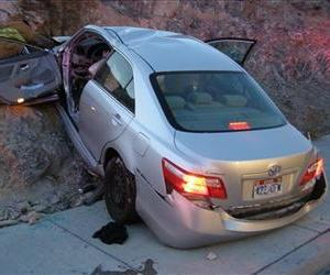 In this Nov. 5, 2010 photo, a Toyota Camry is shown after it crashed in Wendover, Utah. Police suspect problems with its accelerator caused the crash, which left two dead and two others injured.