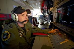 A Royal Australian Air Force airborne electronics analyst watches a radar screen over the southern Indian Ocean during the search operation.