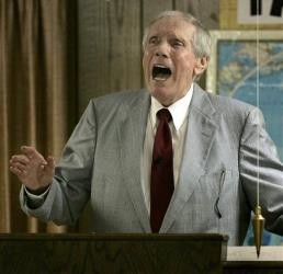 In this March 19, 2006 file photo, Rev. Fred Phelps Sr. preaches at his Westboro Baptist Church in Topeka, Kansas.