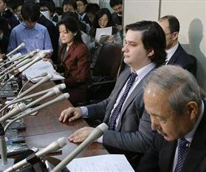 In this Feb. 28, 2014 file photo, Mt. Gox CEO Mark Karpeles, sitting at second right,  attends a press conference at the Justice Ministry in Tokyo.