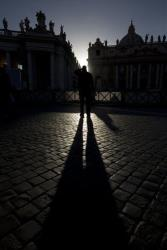 A man stands at sunset in St. Peter's Square at the Vatican, Monday, March 18, 2013.