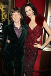 This Nov. 13, 2012 photo released by Starpix shows Mick Jagger and his girlfriend L'Wren Scott at the HBO premiere of his film,  Crossfire Hurricane, at The Ziegfeld Theatre in New York.