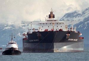 Tugboats pull the crippled tanker Exxon Valdez toward Naked Island in Alaska's Prince William Sound, in this Wednesday, April 5, 1989, file photo.