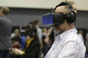 A man tries the Oculus virtual reality headset at the Game Developers Conference 2014 in San Francisco last week.