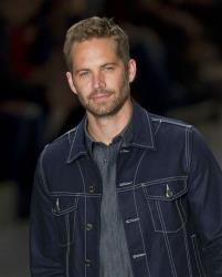 This March 21, 2013 file photo shows Paul Walker wearing a creation from the Colcci summer collection at Sao Paulo Fashion Week in Sao Paulo, Brazil.
