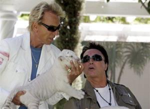 Siegfried Fischbacher, left, and Roy Horn, of the illusionist team Siegfried & Roy, play with a six-week-old white-striped tiger cub at their Las Vegas home, Thursday, June 12, 2008.
