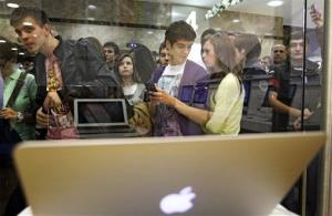 Young Russians line up  at an Apple Macintosh shop to buy iPads in Moscow, Russia, Friday, May 27, 2011.