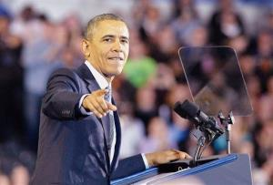 President Barack Obama talks to the crowd at Central Connecticut State University during a speech Wednesday, March 5, 2014, about raising the minimum wage.