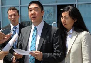 Matthew and Grace Huang, charged with starving to death their 8-year-old adopted daughter, speak outside a courthouse before their trial in Doha, Qatar, Thursday, March 27, 2014.