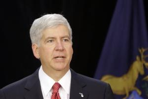 In this July 19, 2013, file photo, Michigan Gov. Rick Snyder speaks during a news conference in Detroit.