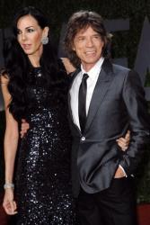 Singer Mick Jagger and his girlfriend L'Wren Scott arrive at the Vanity Fair Oscar party on Sunday, Feb. 22, 2009, in West Hollywood, Calif.