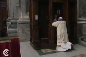 A screen grab from Catholic News Service video of the pope's confession, via YouTube.
