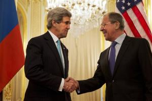 John Kerry, left, shakes hands with Russian Foreign Minister Sergey Lavrov before their meeting at the Russian ambassador's residence about the situation in Ukraine, in Paris, March 30, 2014.