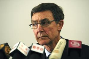 Former Australian defense chief Angus Houston briefs the press on the search.