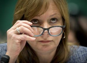 General Motors CEO Mary Barra lowers her eyeglasses as she testifies on Capitol Hill.