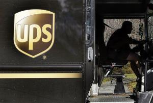 In this Monday, Oct. 22, 2012, photo, a UPS driver drives after a delivery in North Andover, Mass.