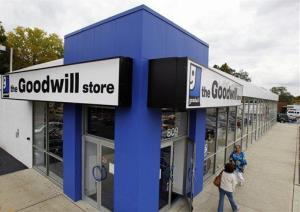 In this Oct. 14, 2010 photo, shoppers go into a Goodwill store in Paramus, NJ.