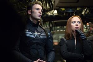 This image released by Marvel shows Chris Evans, left, and Scarlett Johansson in a scene from Captain America: The Winter Soldier.