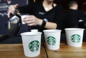 Sandy Roberts, Starbucks strategy manager for global coffee engagement, pours samples of coffee, Wednesday, March 19, 2014.