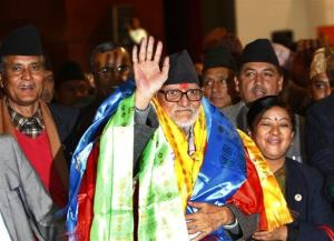 Nepal's newly elected Prime Minister Sushil Koirala waves at the Constitution Assembly Hall in Katmandu, Monday, Feb. 10, 2014.