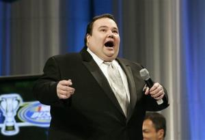 Comedian John Pinette entertains the guests at the NASCAR Busch Series auto racing awards banquet in Orlando, Fla.