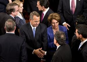 John Boehner enters the House of Representatives chamber in Washington, Jan. 3, 2013. He is escorted by House Majority Leader Eric Cantor of Va., and House Minority Leader Nancy Pelosi of Calif.