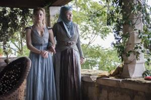 This image released by HBO shows Natalie Dormer, left, and Diana Rigg in a scene from Game of Thrones.