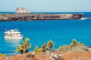 A tourist boat visits the Galapagos Islands.