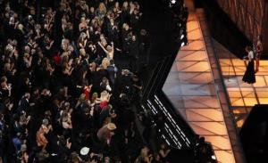 Taylor Swift hugs her mom Andrea after Reba McEntire announced her as the winner of the entertainer of the year award during the 45th Annual CMA Awards in Nashville, Tenn., on Wednesday, Nov. 9, 2011.