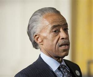 Rev. Al Sharpton before taking his seat in the East Room of the White House, Feb. 27, 2014.