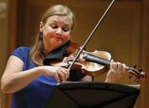 """In this Thursday, March, 27, 2014 photo, Margaret Batjer, concertmaster of the Los Angeles Chamber Orchestra, plays the the 1716 Milstein"""" Stradivarius at the Colburn School in Los Angeles."""