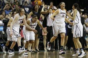 Connecticut players leave the bench after the second half of the championship game against Notre Dame in Nashville.