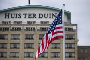 The US flag flies outside Hotel Huis ter Duin, where a Secret Service agent was found drunk in the western Netherlands, Wednesday, March 26, 2014.