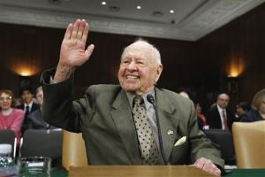 In this Wednesday, March 2, 2011, file photo, entertainer Mickey Rooney waves on Capitol Hill in Washington, prior to testifying about elder abuse, before the Senate Aging Committee.