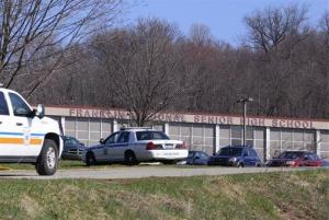 Emergency vehicles are parked around Franklin Regional High School, where several people were stabbed on Wednesday, April 9, 2014, in Murrysville, Pa., near Pittsburgh.