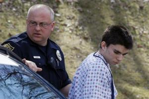 Alex Hribal, the suspect in the multiple stabbings at the Franklin Regional High School in Murrysville, Pa., is escorted by police to a court in Export, Pa.