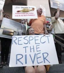 Protesters demonstrate against plans to build a giant twin tunnel system to move water from the Sacramento-San Joaquin River Delta to farmland and cities.