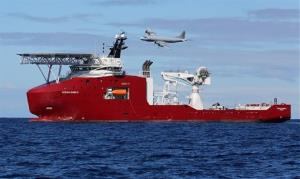 A Royal Australian Air Force AP-3C Orion flies past Australian Defense vessel Ocean Shield yesterday, on a mission to drop sonar buoys in search of the missing Malaysia Airlines Flight 370.