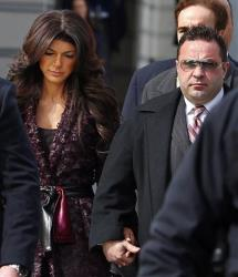 "Teresa, left, and Joe Giudice, from ""The Real Housewives of New Jersey,"" leave federal court in Newark, NJ, on Tuesday, March 4, 2014."