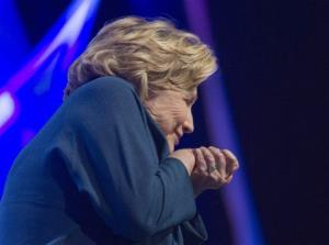 Hillary Clinton ducks during her speech in Las Vegas today.