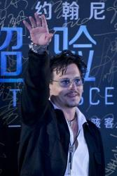 "Johnny Depp attends a promotional event for his new movie ""Transcendence"" in Beijing, China, Monday, March 31, 2014."