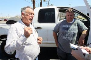 Embattled Bunkerville rancher Cliven Bundy, left, and his son Dave Bundy talk to a reporter in downtown Las Vegas April 7, 2014.