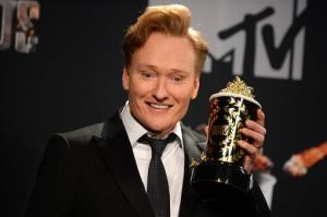 Conan O'Brien poses in the press room at the MTV Movie Awards on Sunday, April 13, 2014, at Nokia Theatre in Los Angeles.