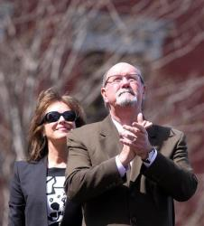 Boston Marathon bombing survivor John Odom stands with his wife Karen during a flag-raising ceremony at Boston Medical Center yesterday.