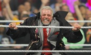 In this Monday, April 7, 2014 photo, James Hellwig, better known as The Ultimate Warrior, performs for the audience during WWE Monday Night Raw at the Smoothie King Center in New Orleans.