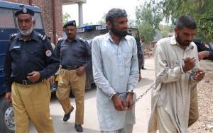 Pakistani police officers escort Farman Ali, right, and Arif Ali, two brothers suspected of cannibalism to a local court in Sargodha, Pakistan, Tuesday, April 15, 2014.