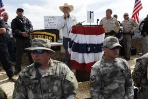 Rancher Cliven Bundy, middle, addresses his supporters alongside Clark County Sheriff Doug Gillespie, right, on April 12, 2014.