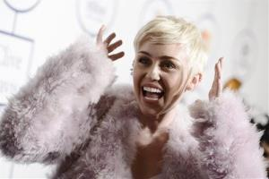Miley Cyrus arrives at the 56th annual GRAMMY awards in January.