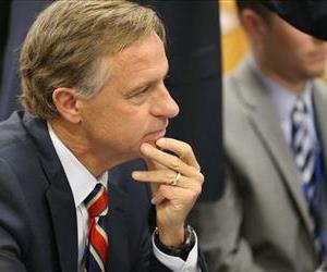 Tennessee Gov. Bill Haslam discusses Common Core with officials at Cedar Grove Elementary School in Smyrna, Tenn., in this March 18, 2014 file photo.