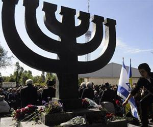 People lay flowers to a menorah monument close to a Babi Yar ravine where Nazis machine-gunned tens of thousands of Jews during WWII, in Kiev, Ukraine, in this 2010 file photo.